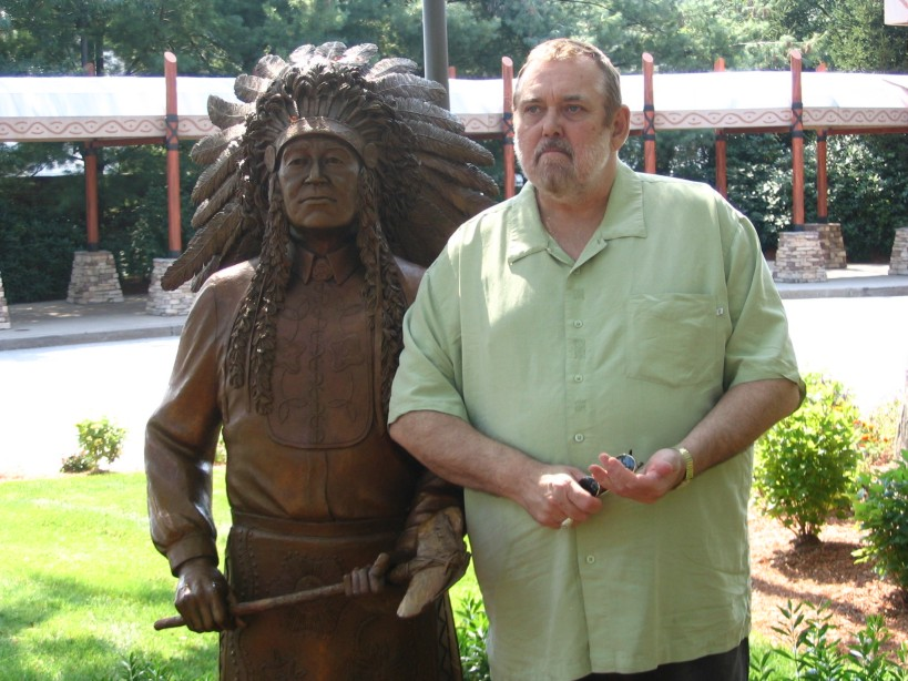Mohegan Sun Casino Jim Brochu stands with Indian Chief